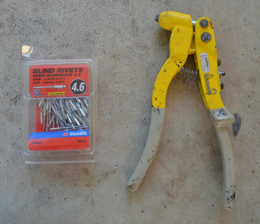 photo of a rivet gun and pack of rivets to make a DIY insect farm