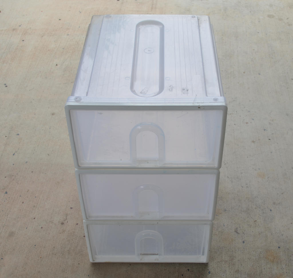 photo of three clear draws on top of each other, for building a DIY insect farm mealworm farm.