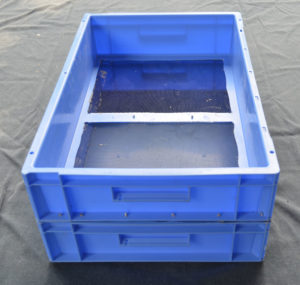 A screen mealworm breeding system, comprising of two blue mealworms trays on top of each other. The top one has a screen on the bottom.The bottom one has a solid base to collect baby mealworms.