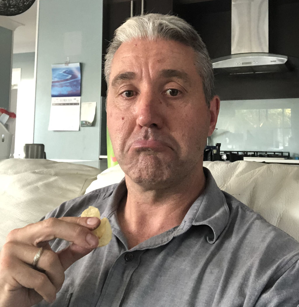 Photo of a sad insect farmer who just discovered he has mites in his insect farm. He bought chips to sooth the soul, however given the pain to follow a bottle of rum would be more appropriate.