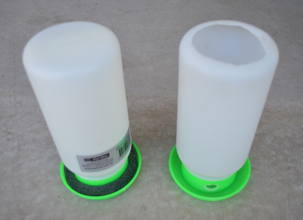 Photo of a insect food and water dispenser for insects such as crickets and cockroaches. Made from chicken water dispenser, white reservoir and green base.