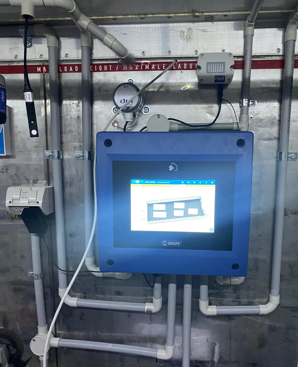 Photo of a large scale insect farm climate control box. Comprises of a large square blue box with screen and tubing coming from it.